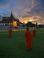 Buddhist Monks and a Storm approaching over the Grand Performance Hall at the Grand Palace in Phnom Penh, Cambodia.