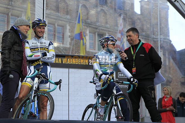 Vacansoleil-DCM Pro Cycling Team riders Lieuwe Westra (NED) and Kris Boeckmans (BEL) on stage at sign on before the start of the 96th edition of The Tour of Flanders 2012 in Bruges Market Square, running 256.9km from Bruges to Oudenaarde, Belgium. 1st April 2012. <br /> (Photo by Eoin Clarke/NEWSFILE).