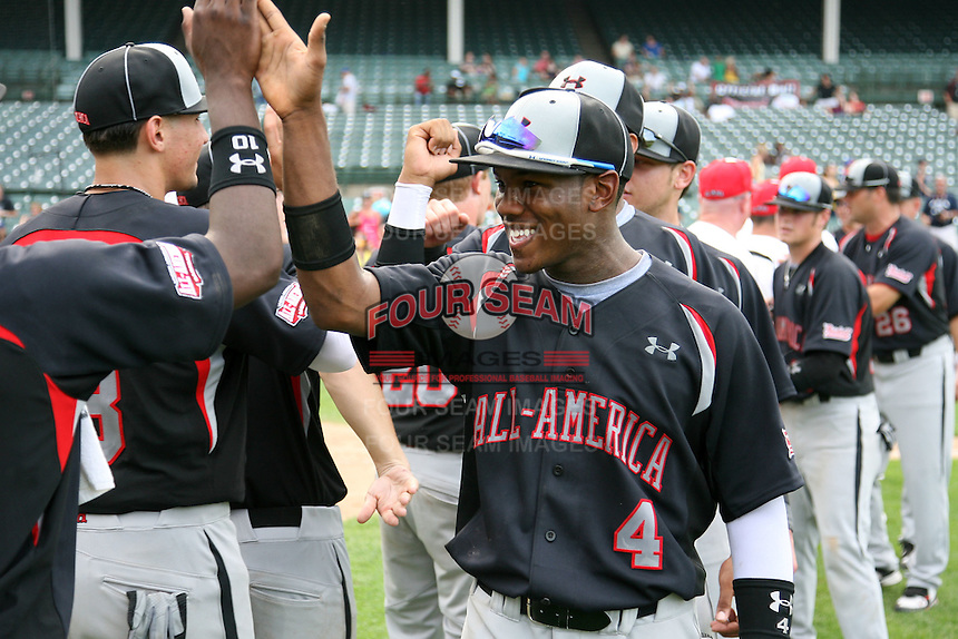 August 8, 2009:  J.D. Williams of Baseball Factory celebrates after winning the Under Armour All-America game at Wrigley Field in Chicago, IL.  Photo By Mike Janes/Four Seam Images