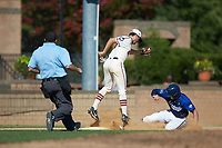 Michael Turconi (4) (Wake Forest) of the High Point-Thomasville HiToms reaches for a high throw as Matthew Suggs (1) (UNC Wilmington) of the Martinsville Mustangs slides into third base while home plate umpire Brian Pitss looks on at Finch Field on July 26, 2020 in Thomasville, NC.  The HiToms defeated the Mustangs 8-5. (Brian Westerholt/Four Seam Images)