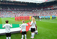 July 26, 2012..Members of UAE team sing National Anthem before 2012 London Olympics group A Football match between United Arab Emirates and Uruguay at Old Trafford in Manchester, England, United Kingdom.  England. Uruguay defeat United Arab Emirates 2-1...