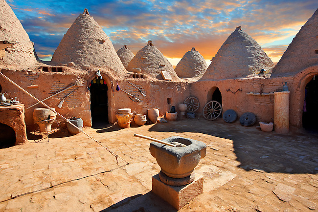 """Pictures of the beehive adobe buildings of Harran, south west Anatolia, Turkey.  Harran was a major ancient city in Upper Mesopotamia whose site is near the modern village of Altınbaşak, Turkey, 24 miles (44 kilometers) southeast of Şanlıurfa. The location is in a district of Şanlıurfa Province that is also named """"Harran"""". Harran is famous for its traditional 'beehive' adobe houses, constructed entirely without wood. The design of these makes them cool inside. 24"""