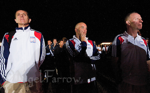 10 SEP 2009 - SOUTHPORT, AUS - British age groupers listen to the tributes for the late Australian triathlete Mark Pringle during the Opening Ceremony for the ITU World Triathlon Championships .(PHOTO (C) NIGEL FARROW)