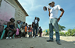 Prelok Pierre Louis (with megaphone), a community health worker for Oganizasyon Sante Popilè (OSAPO), speaks to residents of Montrouis, Haiti, about steps they can take to prevent the spread of cholera, which appeared on the quake-ravaged Caribbean island nation in late 2010. OSAPO's work is supported by Diakonie Katastrophenhilfe and the Lutheran World Federation, both members of the ACT Alliance. Health workers from OSAPO go out to surrounding neighborhoods and communities in teams of three, providing education, distributing anti-bacterial soap and oral rehydration salts, and referring ill patients to the OSAPO clinic...