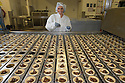 """06/12/16<br /> 06/12/16<br /> <br /> *** Caption correction Paragraph 7 should read 34 million not 400 million*** (In total M&S will sell around 34 million mince pies...)<br /> Paige Farrington, 21.<br /> <br /> Things are REALLY hotting up at Britain's busiest M&S mince pie factory – which will bake a staggering 23 million of the festive favourites in the run-up to Christmas.<br /> <br /> Staff at Park Cakes Bakery in Bolton oversee the production of 375 all-butter pies every minute – that's a phenomenal 22,500 every hour.<br /> <br /> <br /> FULL STORY: https://fstoppressblog.wordpress.com/mince-pies/<br /> <br /> This means a mouth-watering 360,000 mince pies have rolled off the production line every day since the Christmas rush began on September 22.<br /> <br /> And unsurprisingly, quality control is all important with every mince pie having to be the perfect weight, finish and colour so that they pass the retail giant's strict guidelines.<br /> <br /> The actual recipe for the M&S pies is a closely guarded secret with just ten people aware of the full recipe.<br /> <br /> Cooked at 200 degrees Celsius for nine and half minutes, each pie takes 45 minutes to make from start to finish.<br /> <br /> In total M&S will sell around 400 million mince pies – that's an average of six for every man, woman and child in Britain - until the last one rolls off the production line on December 16.<br /> <br /> Bakery employee Megan Davies, 25, said: """"Everyone here takes great pride in producing pies for Marks and Spencer.<br /> <br /> """"It's a really busy period for us, but we have a great team and everyone is focused on the job in hand.<br /> <br /> """"The best thing about it is the smell of the pies when they come out of the oven – it's divine!<br /> <br /> """"I hadn't really thought before about the actual number of pies we make here, it's incredible to think that many roll off the production line and end up being eaten by people all over the country.""""<br /> <br /> All Rights Re"""