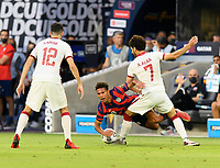 AUSTIN, TX - JULY 29: Nicholas Gioacchini #8 of the United States is knocked off his feet by Ahmed Alaa #7 of Qatar during a game between Qatar and USMNT at Q2 Stadium on July 29, 2021 in Austin, Texas.