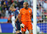 A dejected USA goalkeeper Tim Howard walks past team-mate Jay DeMerit. USA vs Slovenia in the 2010 FIFA World Cup at Ellis Park in Johannesburg, South Africa on June 18th, 2010.