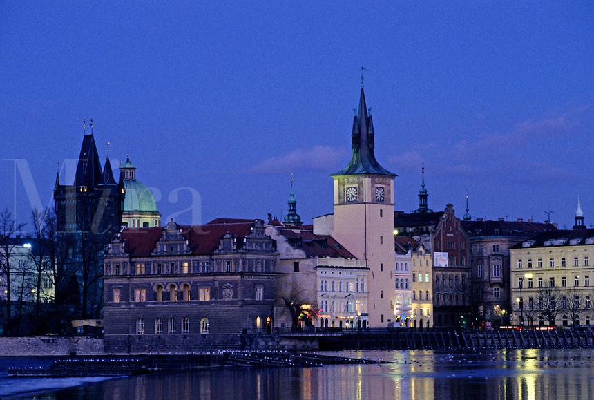 City lights reflect in the VLTAVA RIVER in historic PRAGUE - CZECH REPUBLIC