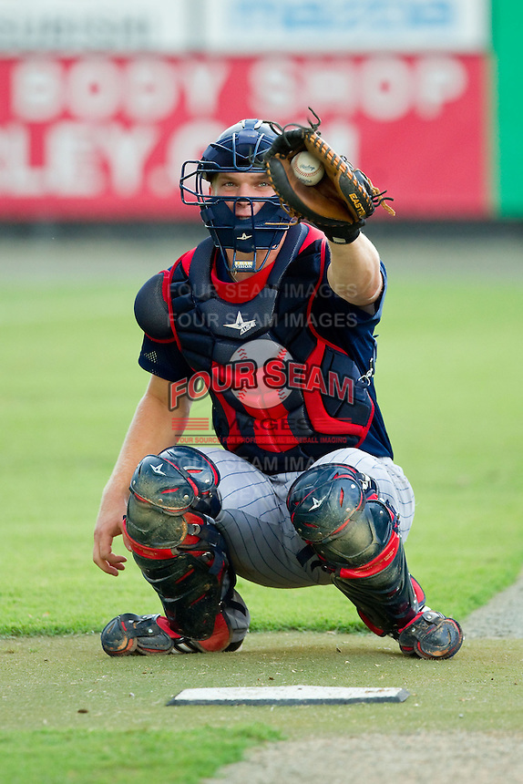 Elizabethton Twins catcher Stuart Turner (31) warms up his starting pitcher in the bullpen prior to the game against the Burlington Royals at Burlington Athletic Park on August 11, 2013 in Burlington, North Carolina.  The Twins defeated the Royals 12-5.  (Brian Westerholt/Four Seam Images)