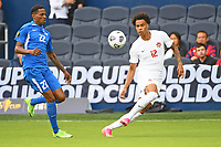 KANSASCITY, KS - JULY 11: Tajon Buchanan #12 of Canada crosses the ball during a game between Canada and Martinique at Children's Mercy Park on July 11, 2021 in KansasCity, Kansas.