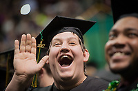 Joshua A. C. Johnson, Bachelor of Business Administration Management, waves to friends and family during the UAA 2017 Fall Commencement.