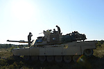 "American soldiers with Delta Company, 2nd Battalion, 7th Infantry Regiment, 1st Armored Brigade Combat Team, 3rd Infantry Division with M1A2 Abrams tanks before a tank training exercise practicing infiltration at the Drawsko Pomorskie Training Area in Poland on June 12, 2015.    NATO is engaged in a multilateral training exercise ""Saber Strike,"" the first time Poland has hosted such war games, involving the militaries of Canada, Denmark, Germany, Poland, and the United States."