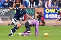 25th September 2021; Kilmac Stadium, Dundee, Scotland: Scottish Premiership football, Dundee versus Rangers; Ryan Sweeney of Dundee tackles Ianis Hagi of Rangers from behinid