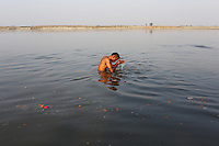 A man bathes in the Ganges River at the city of Kanpur. The river has become heavily polluted at this point along the river because of pollution from nearby leather tanneries.