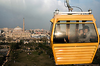 A family rides a cable car over Shaidar Park in Erbil. ..