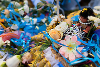 A basket of flowers and jewelry offered as a gift during the celebration of Yemanjá, the goddess of the sea, in Salvador, Bahia, Brazil, 2 February 2012. Yemanjá, originally from the ancient Yoruba mythology, is one of the most popular ?orixás?, the deities from the Afro-Brazilian religion of Candomblé. Every year on February 2nd, thousands of Yemanjá devotees participate in a colorful celebration in her honor. Faithful, usually dressed in the traditional white, gather on the beach at dawn to leave offerings for their goddess. Gifts for Yemanjá include flowers, perfumes or jewelry. Dancing in the circle and singing ancestral Yoruba prayers, sometimes the followers enter into a trance and become possessed by the spirits. Although Yemanjá is widely worshipped throughout Latin America, including south of Brazil, Uruguay, Cuba or Haiti, the most popular cult is maintained in Bahia, Brazil.