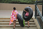 Friends with inner tubes in Confluence Park, Denver, Colorado, USA.