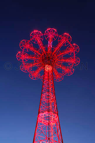 THIS IMAGE IS AVAILABLE EXCLUSIVELY FROM GETTY IMAGES<br /> <br /> PLEASE SEARCH FOR IMAGE # sb10069646b-002 ON WWW.GETYIMAGES.COM<br /> <br /> Upward View of the Parachute Jump (landmarked former amusement park ride) on the Boardwalk at Coney Island, illuminated at dusk.....Coney Island, Brooklyn, New York City, New York State, USA