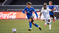 SAN JOSE, CA - MAY 15: Cade Cowell #44 of the San Jose Earthquakes dribbles past Yimmi Chara #23 of the Portland Timbers during a game between San Jose Earthquakes and Portland Timbers at PayPal Park on May 15, 2021 in San Jose, California.