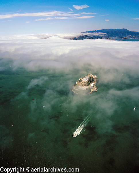 aerial photograph ferry departing Alcatraz Island fog enters San Francisco Bay