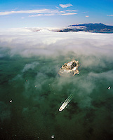 aerial photograph ferry departing Alcatraz Island fog enters San Francisco Bay