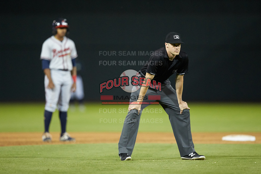 Umpire Evin Johnson handles the calls on the bases during the South Atlantic League game between the Rome Braves and the Columbia Fireflies at Segra Park on May 13, 2019 in Columbia, South Carolina. The Fireflies defeated the Braves 6-1 in game two of a doubleheader. (Brian Westerholt/Four Seam Images)