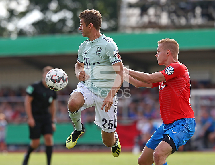 18.08.2018, Football DFB Pokal 2018/2019, 1. round, SV Drochtersen Assel - FC Bayern Muenchen, Kehdinger stadium Drochtersen.  Thomas Mueller (Bayern Muenchen)  -  and Laurens Rogowski (SV Drochtersen-Assel)<br /><br /><br />***DFB rules prohibit use in MMS Services via handheld devices until two hours after a match and any usage on internet or online media simulating video foodaye during the match.*** *** Local Caption *** © pixathlon<br /> <br /> Contact: +49-40-22 63 02 60 , info@pixathlon.de