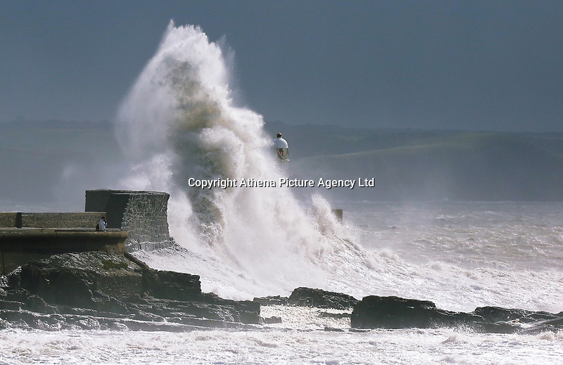 """WEATHER PICTURE WALES<br /> Pictured: Waves crashing against the harbour wall and lighthouse in Porthcawl, Wales, UK. Monday 11 September 2017<br /> Re: A yellow """"be aware"""" weather warning of very strong winds has been issued across south and west Wales The Met Office HAS warned.<br /> Gusts could reach 50 mph inland and 60 mph along the coast."""