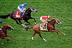 LOUISVILLE, KY - MAY 07: Isabella Sings #4, ridden by John Velazquez, leads the field past the grandstands for the first time during the Churchill Distaff Turf Mile as Tepin #1 (C), ridden by Julien Leparoux, and Zipessa #8 (L), ridden by Florent Geroux, follow on May 7, 2016 in Louisville, Kentucky. Tepin #1, ridden by Julien Leparoux, won the race. (Photo by Jon Durr/Eclipse Sportswire/Getty Images)