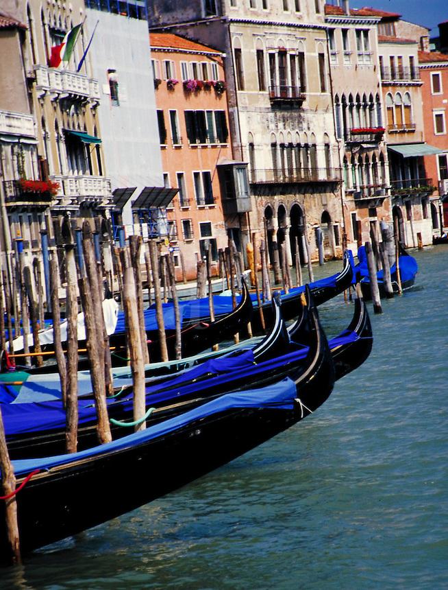 The gondolas of Venice, Italy await the next passengers. boat, boats, transportation, cityscape, waterways. Venice, Italy.