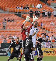 DC United goalkeeper Troy Perkins  (23) goes up to defend the play against Real Salt Lake forward Alvaro Saborio (15)  DC United defeated Real Salt Lake 2-1 to advance to the round of 16 of the  U.S. Open Cup at RFK Stadium, Wednesday  June 2  2010.