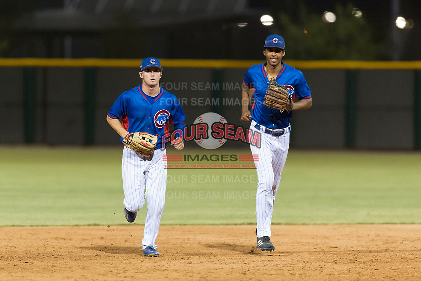 AZL Cubs 2 outfielders Cole Roederer (34) and Brennen Davis (21) jog off the field between innings of an Arizona League game against the AZL Indians 2 at Sloan Park on August 2, 2018 in Mesa, Arizona. The AZL Indians 2 defeated the AZL Cubs 2 by a score of 9-8. (Zachary Lucy/Four Seam Images)