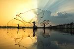 Three fishermen throw their nets by Zay Yar Lin
