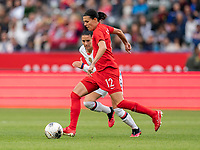 CARSON, CA - FEBRUARY 9: Christine Sinclair #12 of the United States dribbles past Ali Krieger #11 of the United States during a game between Canada and USWNT at Dignity Health Sports Park on February 9, 2020 in Carson, California.