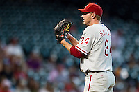 Philadelphia Phillies pitcher Roy Halladay #34 looks in for the sign during the Major League baseball game against the Houston Astros on September 16th, 2012 at Minute Maid Park in Houston, Texas. The Astros defeated the Phillies 7-6. (Andrew Woolley/Four Seam Images).