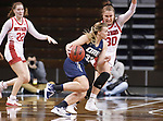 SIOUX FALLS, SD - MARCH 6: Keni Jo Lippe #33 of the Oral Roberts Golden Eagles drives into Jeniah Ugofsky #30 of the South Dakota Coyotes during the Summit League Basketball Tournament at the Sanford Pentagon in Sioux Falls, SD. (Photo by Richard Carlson/Inertia)