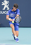 March 26, 2019: Novak Djokovic (SRB) is defeated by Roberto Bautista Agut (ESP) 6-1, 5-7, 3-6, at the Miami Open being played at Hard Rock Stadium in Miami, Florida. ©Karla Kinne/Tennisclix 2010/CSM