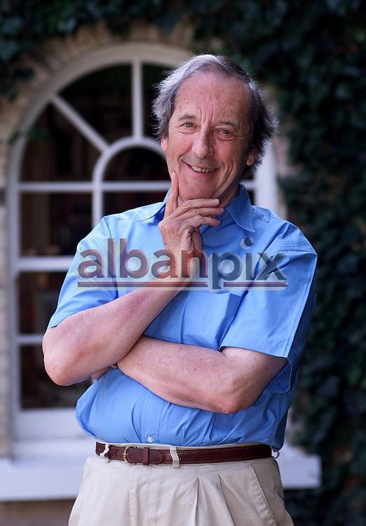 Author Malcolm Bradbury at his Norwich home.