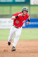 Danny Hayes (32) of the Kannapolis Intimidators hustles towards third base against the West Virginia Power at CMC-Northeast Stadium on April 30, 2014 in Kannapolis, North Carolina.  The Intimidators defeated the Power 2-1 in game one of a double-header.  (Brian Westerholt/Four Seam Images)