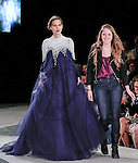 Graduating fashion student Madeline Gruen, walks runway with model at the close of the 2013 Pratt Institute Fashion Show, on April 25, 2013.