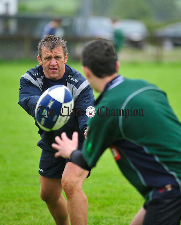 Garryowen coach Greg Oliver helps some of the young players.