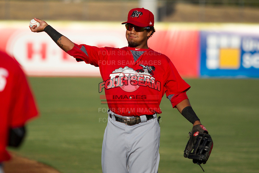 Frisco Roughriders outfielder Teodor Martinez (3) warms up before the Texas League baseball game against the San Antonio Missions on August 22, 2013 at the Nelson Wolff Stadium in San Antonio, Texas. Frisco defeated San Antonio 2-1. (Andrew Woolley/Four Seam Images)
