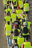 """Bergarbeiterstreik in Spanien.<br />Bergarbeiter auf dem """"Marcha Negra"""" - der schwarze Marsch (schwarz wegen der Farbe der Kohle) - nach Madrid. Sie wollen mit diesem Marsch die Regierung dazu bringen die 63%ige Kuerzung der Bergbaufoerdeung zurueck zu nehmen.<br />30.6.2012, Benavente/Spanien<br />Copyright: Christian-Ditsch.de<br />[Inhaltsveraendernde Manipulation des Fotos nur nach ausdruecklicher Genehmigung des Fotografen. Vereinbarungen ueber Abtretung von Persoenlichkeitsrechten/Model Release der abgebildeten Person/Personen liegen nicht vor. NO MODEL RELEASE! Don't publish without copyright Christian-Ditsch.de, Veroeffentlichung nur mit Fotografennennung, sowie gegen Honorar, MwSt. und Beleg. Konto:, I N G - D i B a, IBAN DE58500105175400192269, BIC INGDDEFFXXX, Kontakt: post@christian-ditsch.de.<br />Urhebervermerk wird gemaess Paragraph 13 UHG verlangt.]"""