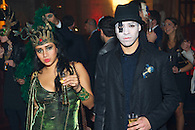 Guests in costume at a Halloween party.