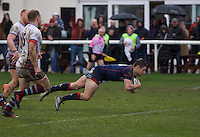 Robbie Fergusson of London Scottish Football Club scores a try during the Greene King IPA Championship match between London Scottish Football Club and Rotherham Titans at Richmond Athletic Ground, Richmond, United Kingdom on 1 January 2017. Photo by Alan  Stanford.