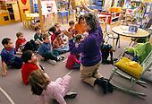 MR/ Schenectady, New York.Yates Arts-in-Education Magnet School / Pre-Kindergarten.Pre-Kindergarten teacher teaches dance movements for school program to students (ages 4-5) and aide (African-American)..MR:YS-9-PK       FC#:23048-00401.scan from slide.©Ellen B. Senisi