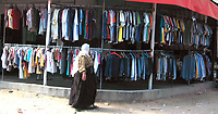 "Used clothing market . Recently Palestinians tend to buy used clothing following the economic blockade imposed on them after the victory of Hamas in the legislative elections last year May.22.2007.""photo by Fady Adwan"""
