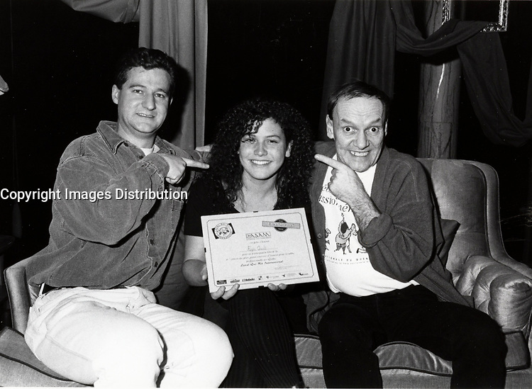 Montreal (QC) CANADA 1997 file photo - Dany Turcotte and other Jury member pose with LAVAL QUI RIT 1997 winner Raja Ouali