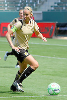 Leslie Osborne #10 of FC Gold Pride attacks the defense of the Los Angeles Sol during their match at Home Depot Center on April 19, 2009 in Carson, California.