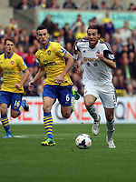 Saturday 28 September 2013<br /> Pictured: Michu of Swansea (R) against Laurent Koscielny (L) of Arsenal<br /> Re: Barclay's Premier League, Swansea City FC v Arsenal at the Liberty Stadium, south Wales.